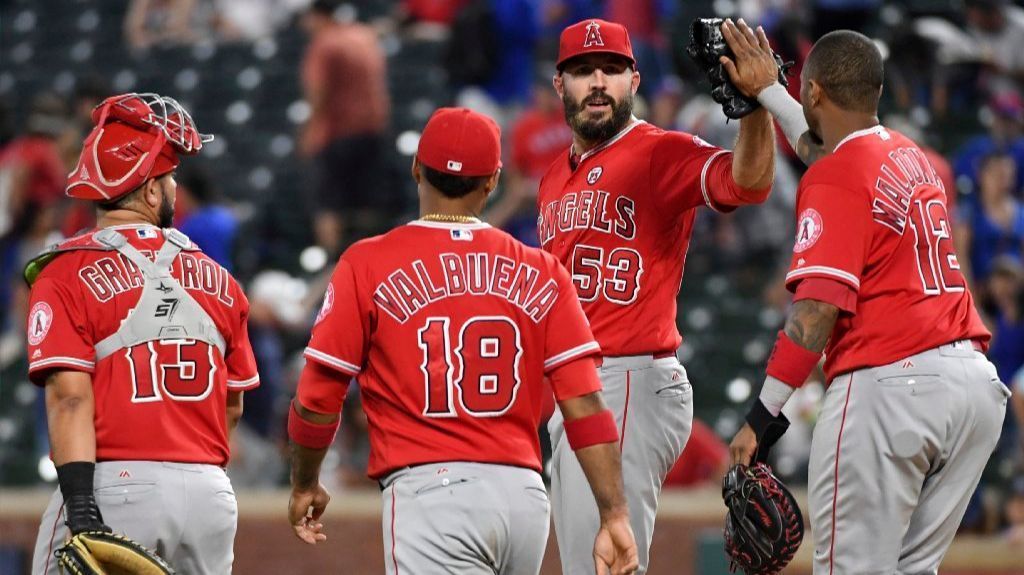 Blake Parker, second from right, is congratulated by Martin Maldonado as Juan Graterol and Luis Valbuena watch after Parker completed a save Sept. 2.