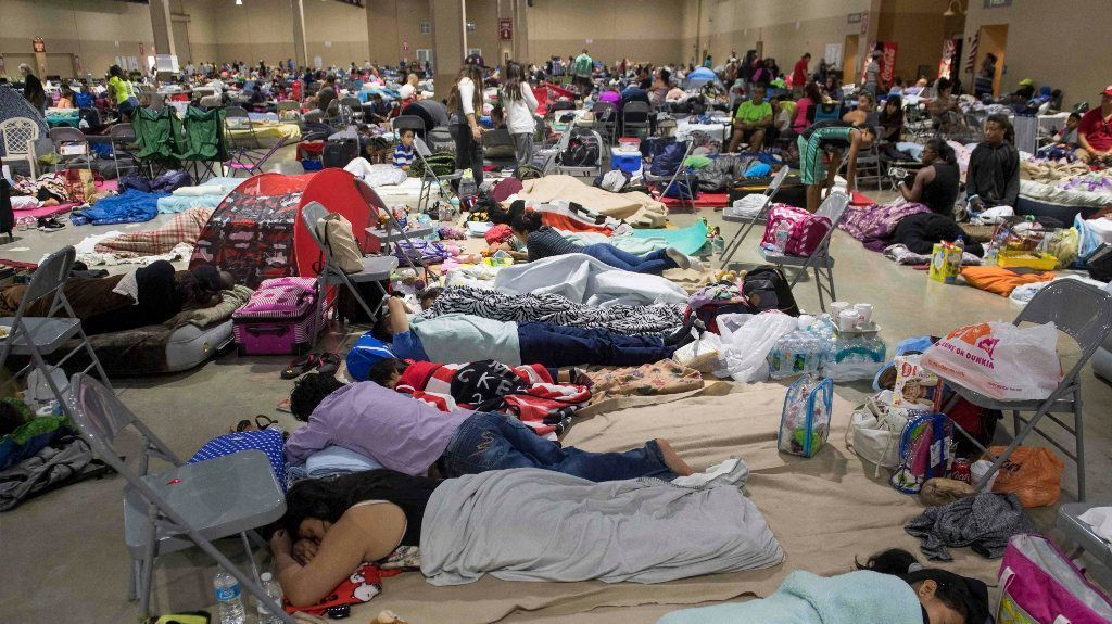 Hundreds of people gather in an emergency shelter at the Miami-Dade County Fair Expo Center in Miami.