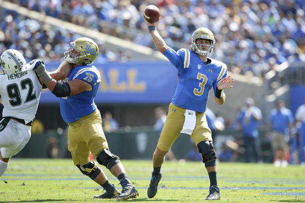 UCLA quarterback Josh Rosen leads the Bruins on a second quarter touchdown drive against Hawaii at the Rose Bowl. (Robert Gauthier / Los Angeles Times)