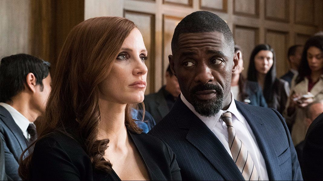 "Jessica Chastain and Idris Elba in the movie ""Molly's Game."""