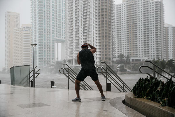 A man stands firm against the wind by the Miami River as Hurricane Irma passes through on Sept. 10, 2017. (Marcus Yam / Los Angeles Times)