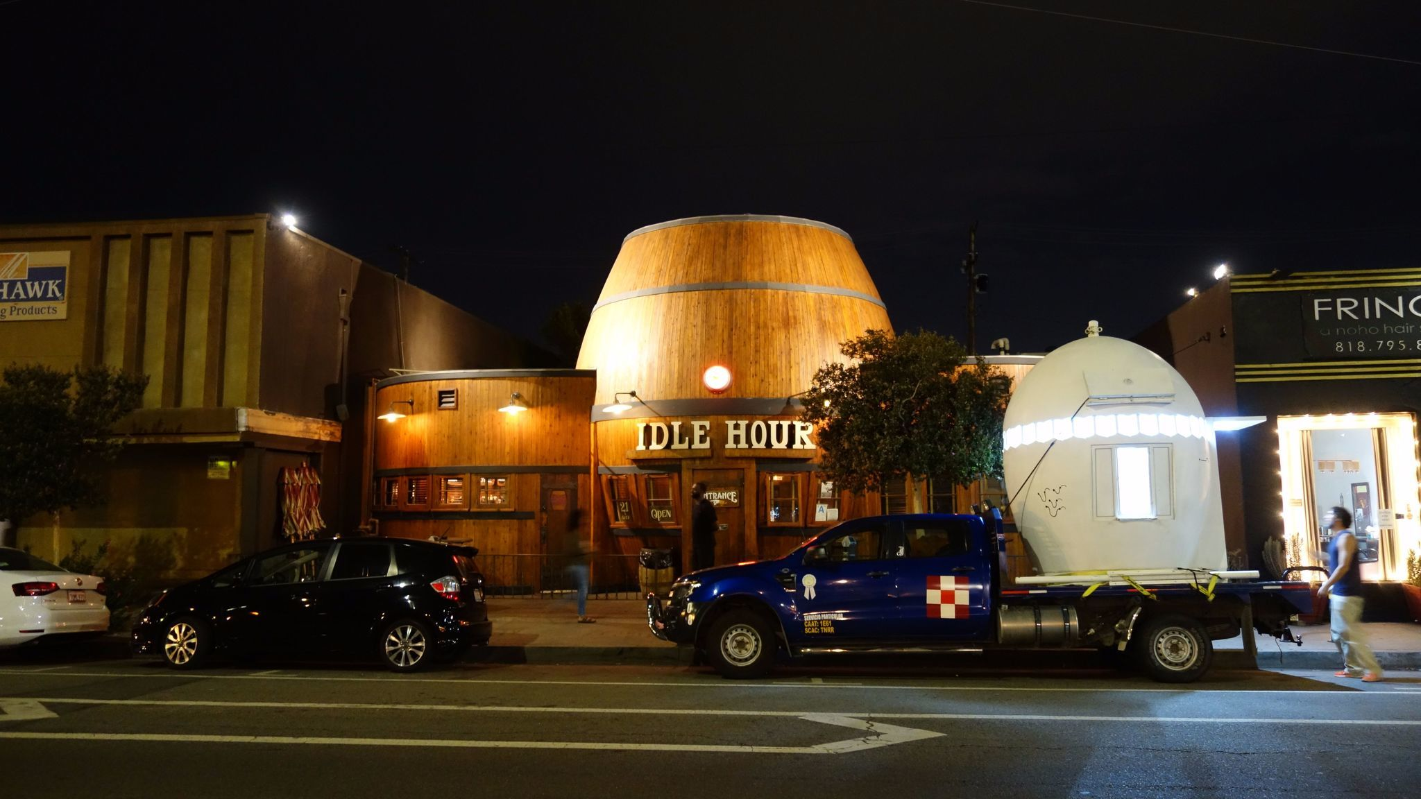 The NuMu parked outside the Idle Hour bar in North Hollywood, which is shaped like a barrel.