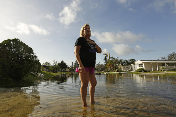 Sue Przybylski stands in shallow water near her home in Naples, Fla. (Carolyn Cole/Los Angeles Times)