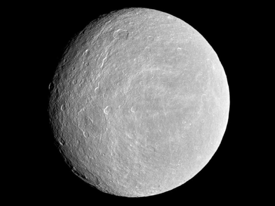 Rhea's thin atmosphere contains oxygen, giving it something in common with Earth.