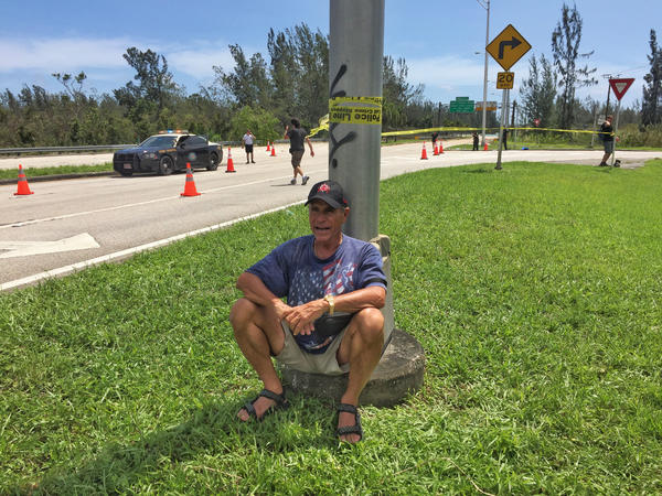 Warren Stincer waits at a checkpoint along Route 1, the only road going in and out of the Florida Keys on Monday. (Marcus Yam / Los Angeles Times)