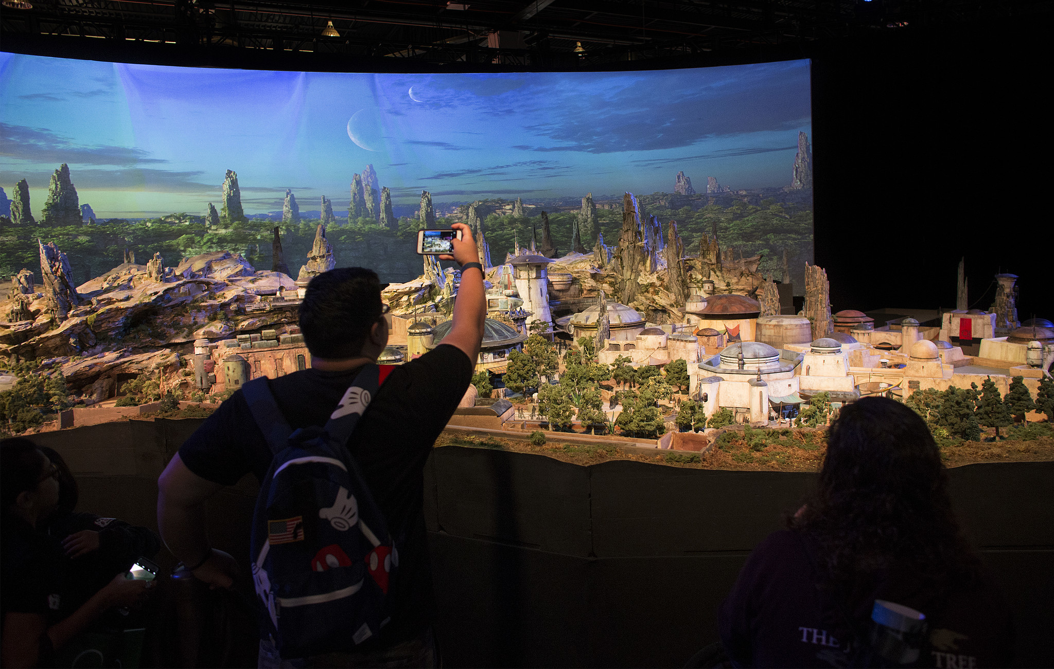 Fans get a preview of stars wars galaxy s edge a new area under construction at disneyland the model was shown at the d23 expo in july