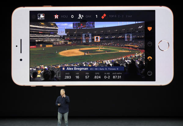 Phil Schiller, Apple's senior vice president of worldwide marketing, shows an augmented reality feature. (Marcio Jose Sanchez / Associated Press)