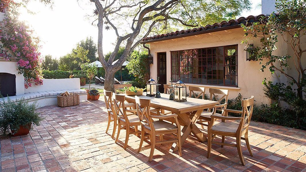 The outdoor teak furniture is from Pottery Barn.