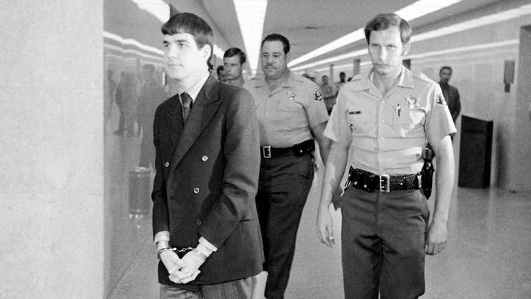 "In this 1971 file photo, Charles ""Tex"" Watson, left, is led back to jail from a courtroom after he was convicted of seven counts of first-degree murder and one count of conspiracy to commit murder."