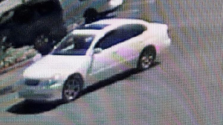 Burbank police released this photo of the suspected getaway vehicle, a white, four-door sedan with c