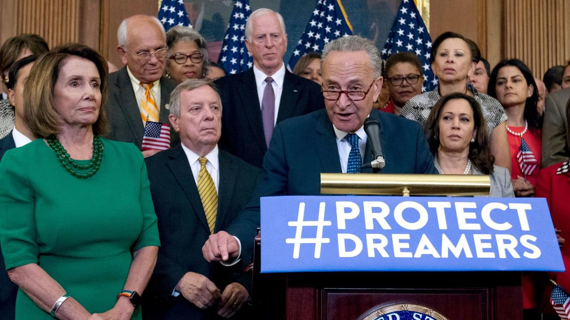 Senate Minority Leader Charles E. Schumer with House Minority Leader Nancy Pelosi, left, and other congressional Democrats. (Jose Luis Magana / Associated Press)