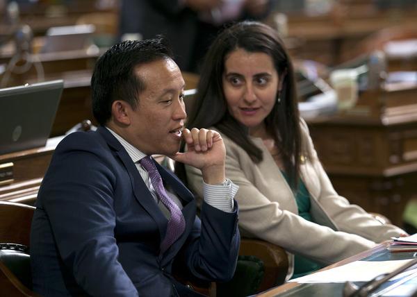 Assemblyman David Chiu (D-San Francisco) talks with Assemblywoman Monique Limon (D-Goleta). (Rich Pedroncelli / Associated Press)