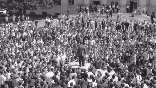 Mario Savio stands atop a police car in front of Sproul Hall on Oct. 1, 1964.