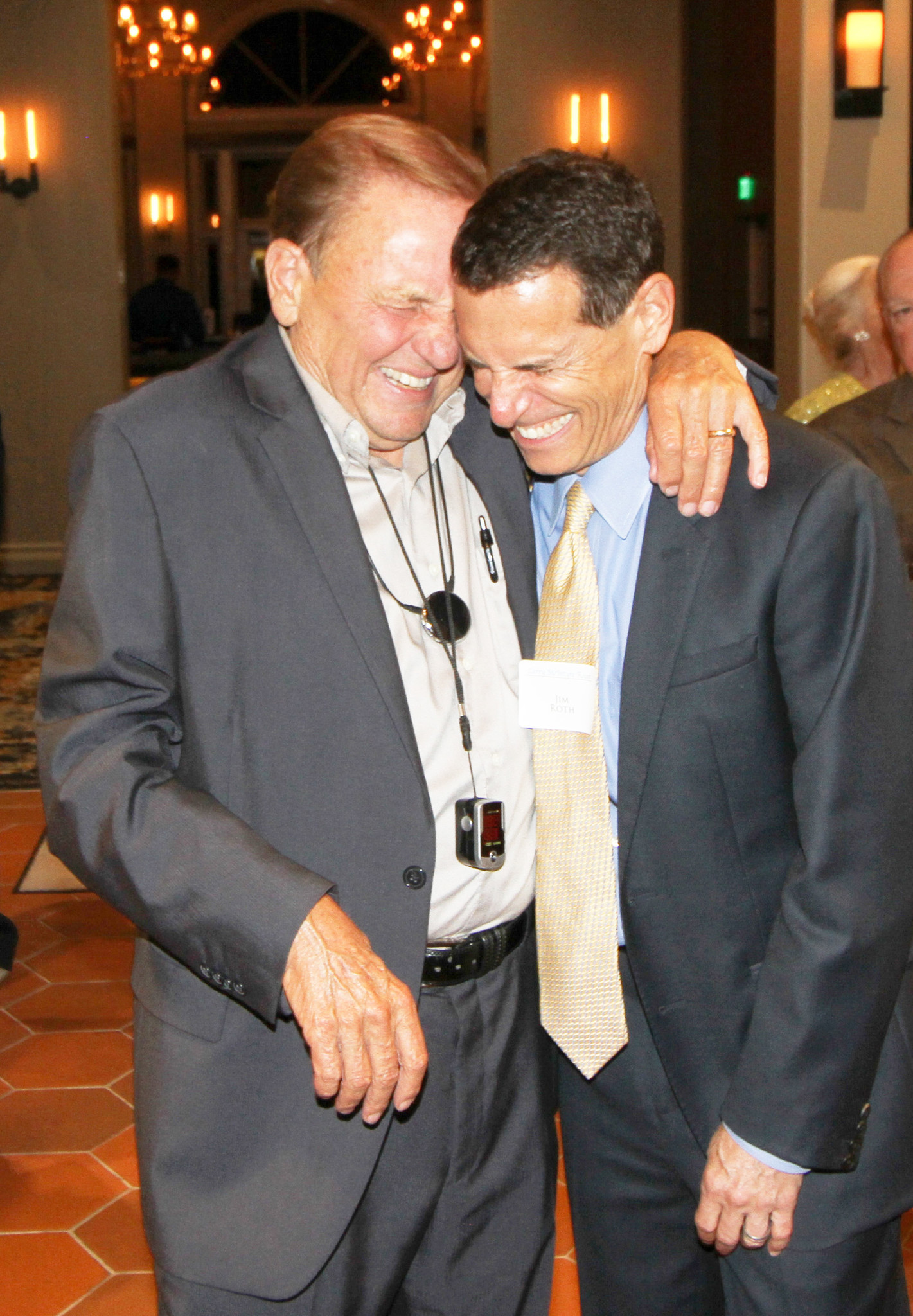 Larry McIntyre and Jim Roth sharing a laugh after the roast, at which Roth was the master of ceremonies.