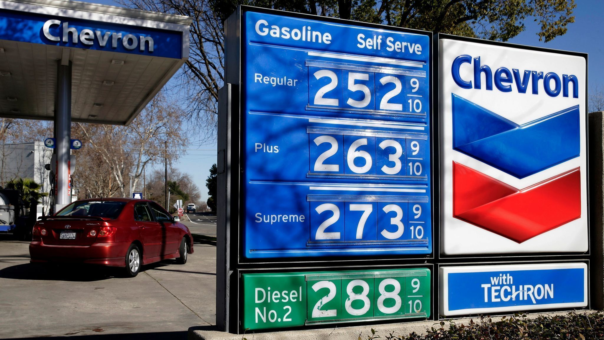 A Chevron gas station in Sacramento shows prices in February. (Rich Pedroncelli / Associated Press)