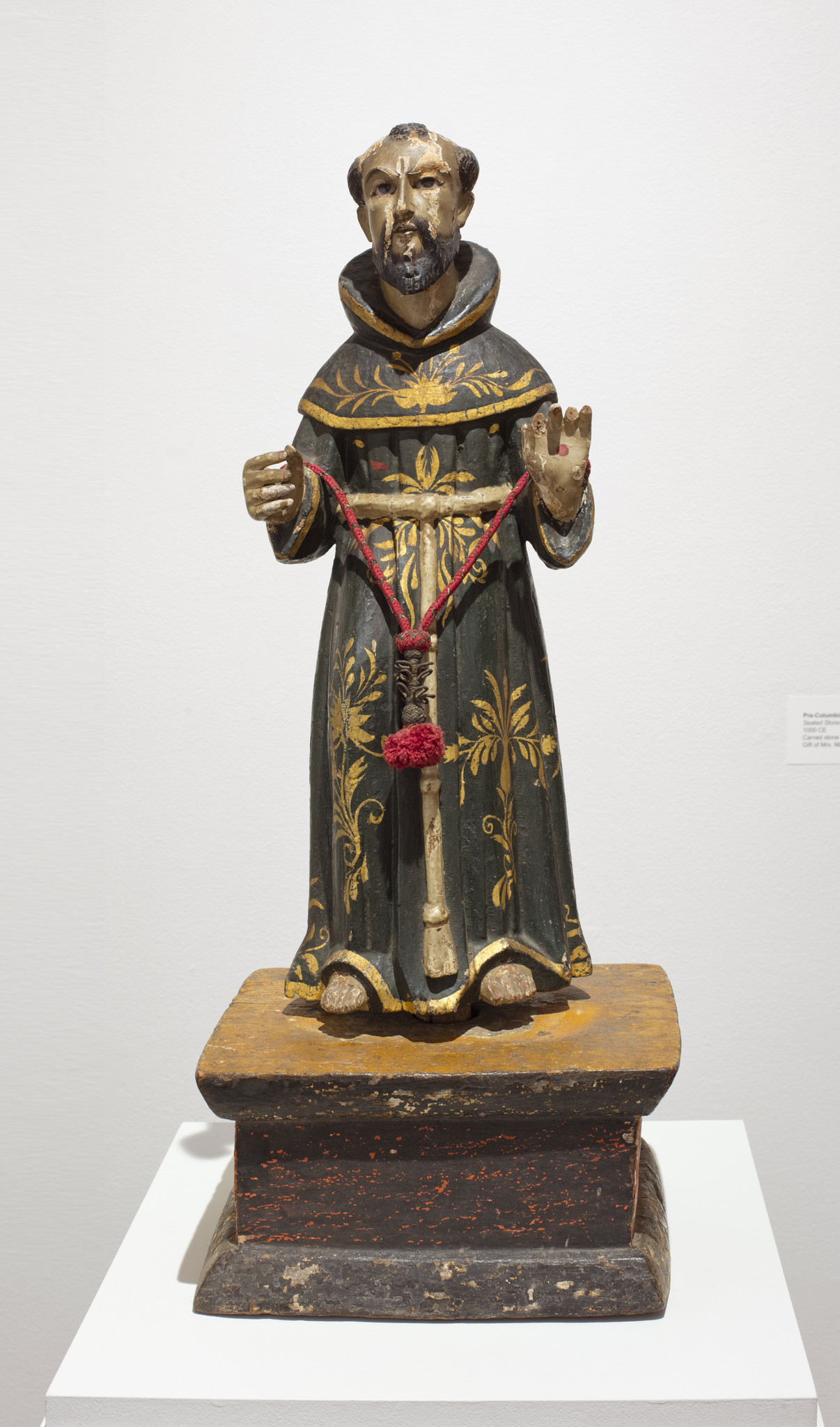 "A carving of a priest made during the Spanish colonial era in California (c. 1725), part of ""Sacred Art in the Age of Contact."""