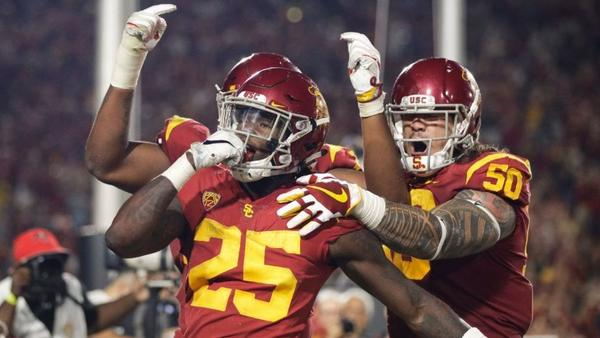 USC running back Ronald Jones II (25) celebrates a touchdown against Stanford with offensive linemen Toa Lobendahn (50) and Chuma Edoga (70) during the second half on Sept. 9. (Jae C. Hong / Associated Press)