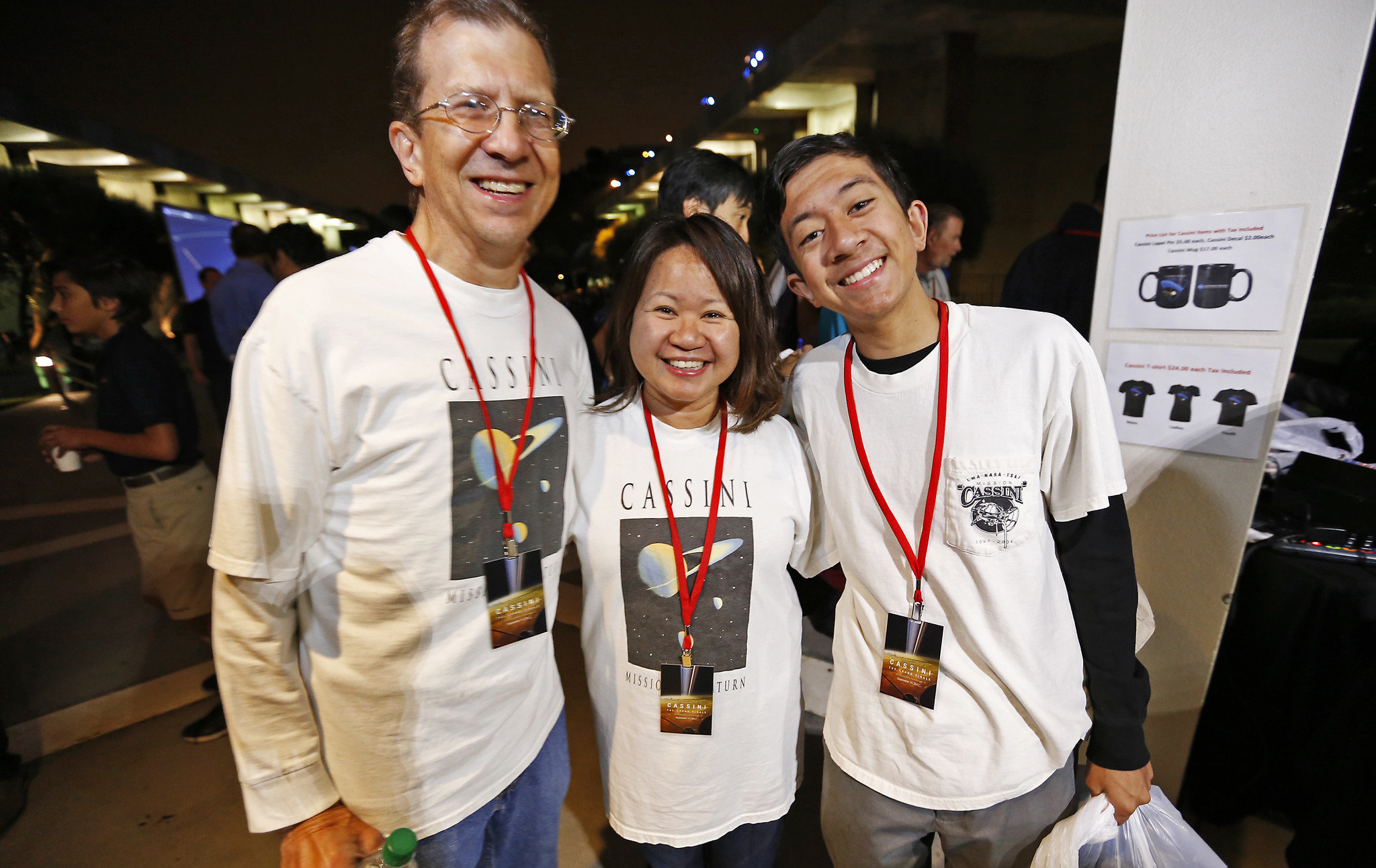 Freia Weisner, center, who works on NASA's Deep Space Network at JPL, wears the original shirt from the 1997 launch. So do husband Mark and son Erik.