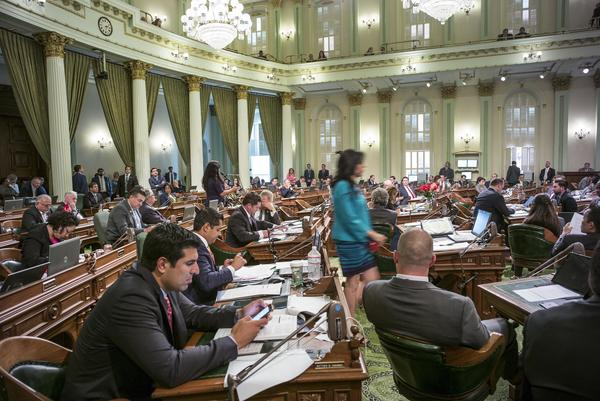 Assembly members work on the final bills of the year on Friday. (David Butow / For The Times)
