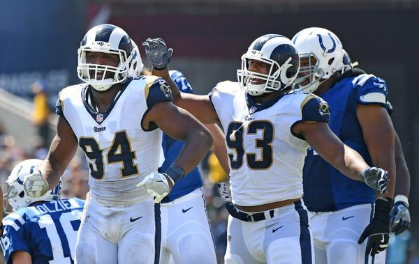Rams defensive ends Robert Quinn (94) celebrates his sack with Ethan Westbrooks (93) during a game against the Colts at the Coliseum on Sept. 10. (Wally Skalij / Los Angeles Times)