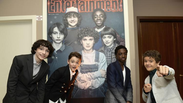 Finn Wolfhard, from left, Noah Schnapp, Caleb McLaughlin and Gaten Matarazzo attend Entertainment Weekly's pre-Emmy party at Sunset Tower Hotel in West Hollywood on Friday. (Matt Winkelmeyer / Getty Images)