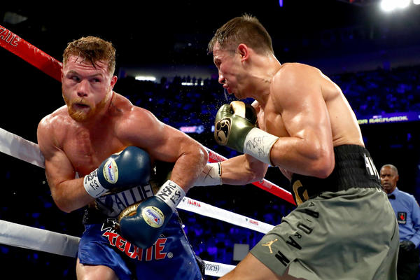 Gennady Golovkin goes to the body against Canelo Alvarez. (Al Bello / Getty Images)