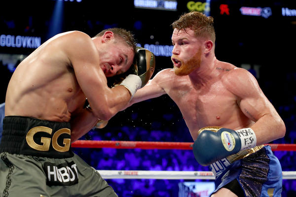 Canelo Alvarez works a combination against Gennady Golovkin during their middleweight title fight. (Al Bello / Getty Images)