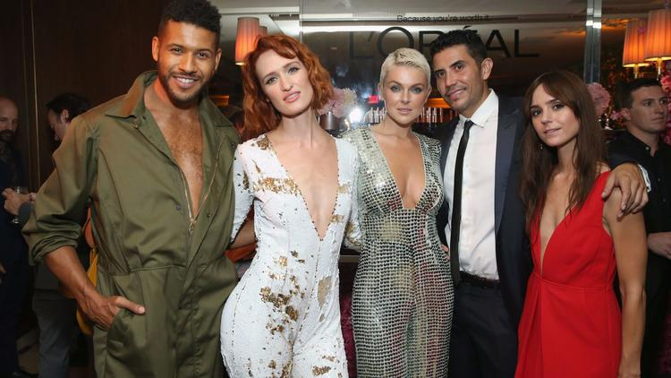"""""""UnREAL's"""" Jeffrey Bowyer-Chapman, from left, Breeda Wool of """"UnREAL"""" and """"Mr. Mercedes,"""" Serinda Swan of """"Inhumans"""" and """"Ballers"""" and guests at party. (Phillip Faraone / Getty Images)"""