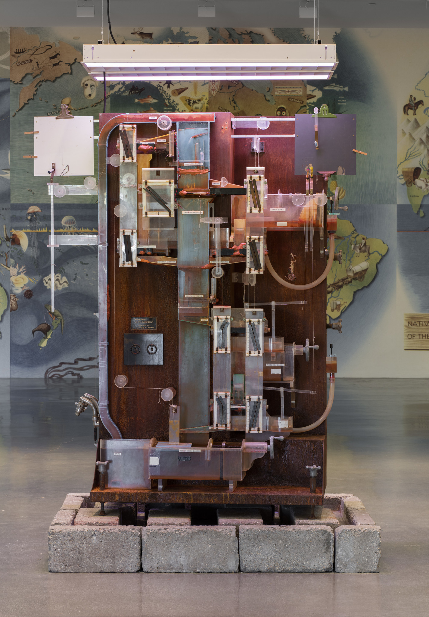 "Michael Stevenson, ""The Fountain of Prosperity,"" 2006. Plexiglas, steel, brass, aluminum, rubber, cork, string, concrete, dyed water, pumps and fluorescent lamps."