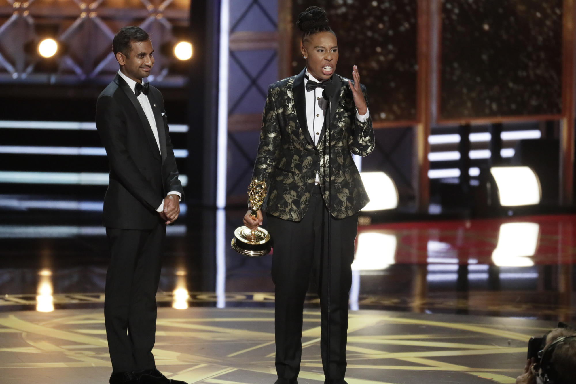 Lena Waithe giving her acceptance speech with Aziz Ansari at the 2017 Emmy Awards. (Robert Gauthier / Los Angeles Times)
