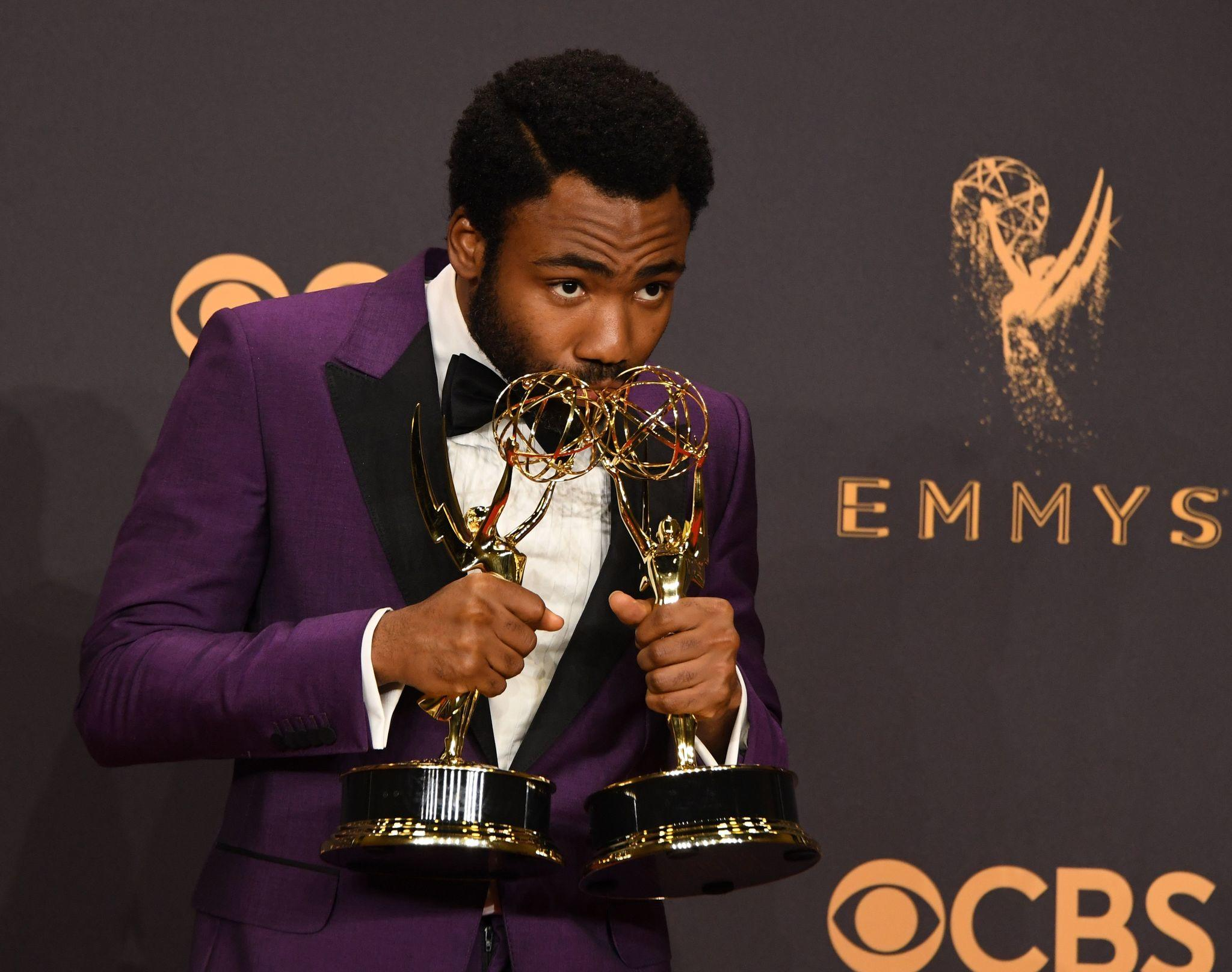 """Donald Glover poses with his Emmys for lead actor in a comedy series and director of a comedy series, for """"Atlanta."""" (Mark Ralston / AFP / Getty Images)"""
