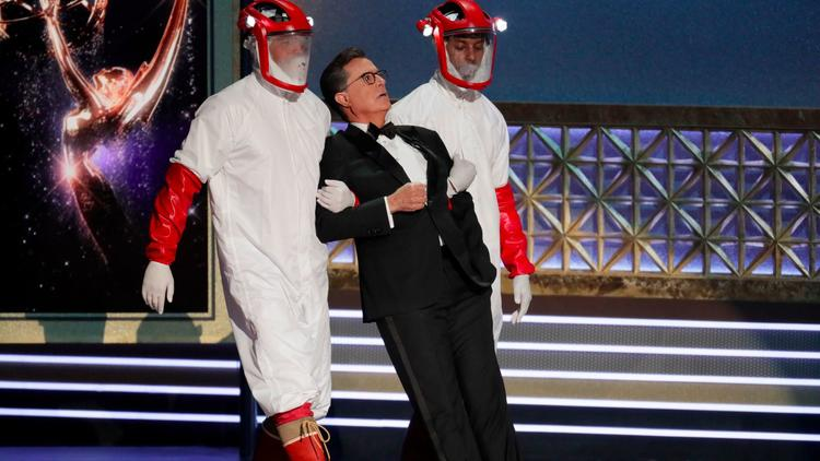"Emmys host Stephen Colbert being carried in a bit inspired by HBO's ""Westworld."" (Robert Gauthier / Los Angeles Times)"