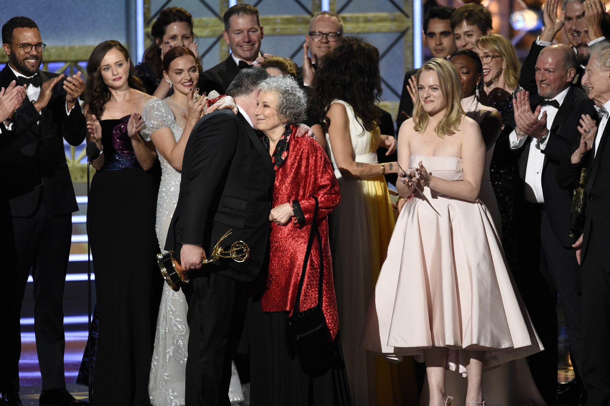 "Bruce Miller, from left, Margaret Atwood and Elisabeth Moss accept the Emmy for drama series for ""The Handmaid's Tale."" (Chris Pizzello/Invision/AP)"
