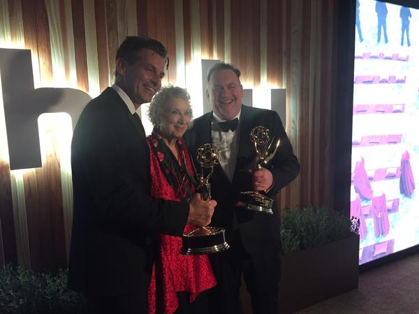 "Hulu CEO Mike Hopkins, author Margaret Atwood and writer-producer Bruce Miller celebrate ""The Handmaid's Tale's"" Emmy win for best drama at the Hulu party. (Yvonne Villarrea / Los Angeles Times)"