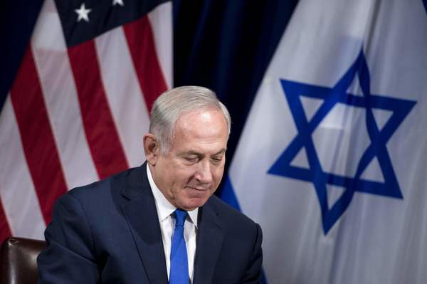 Israeli Prime Minister Benjamin Netanyahu faces reporters before a meeting with President Trump. (BRENDAN SMIALOWSKI / AFP/Getty Images)