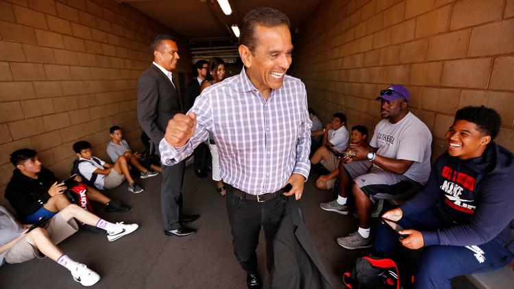 Antonio Villaraigosa gives a pep talk in Los Angeles at Cathedral High School, where he once was also a student. (Al Seib / Los Angeles Times)