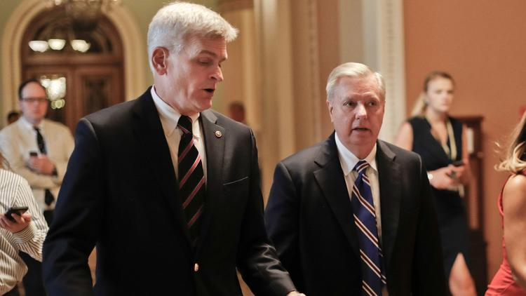 GOP Sens. Bill Cassidy of Louisiana, left, and Lindsey Graham of South Carolina confer on their last-minute measure to repeal the Affordable Care Act. (Pablo Martinez Monsivais / Associated Press)