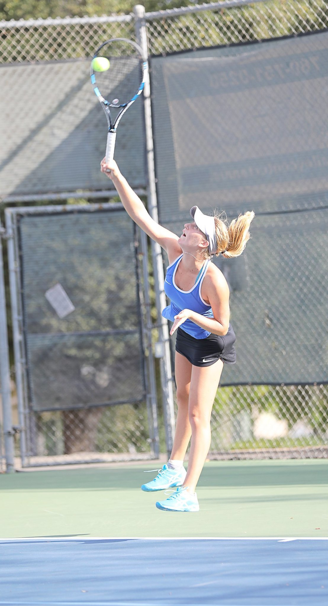 Julia Failla, who has a 24-0 record, leaps for the ball and wins three sets against her Jaguar opponent.