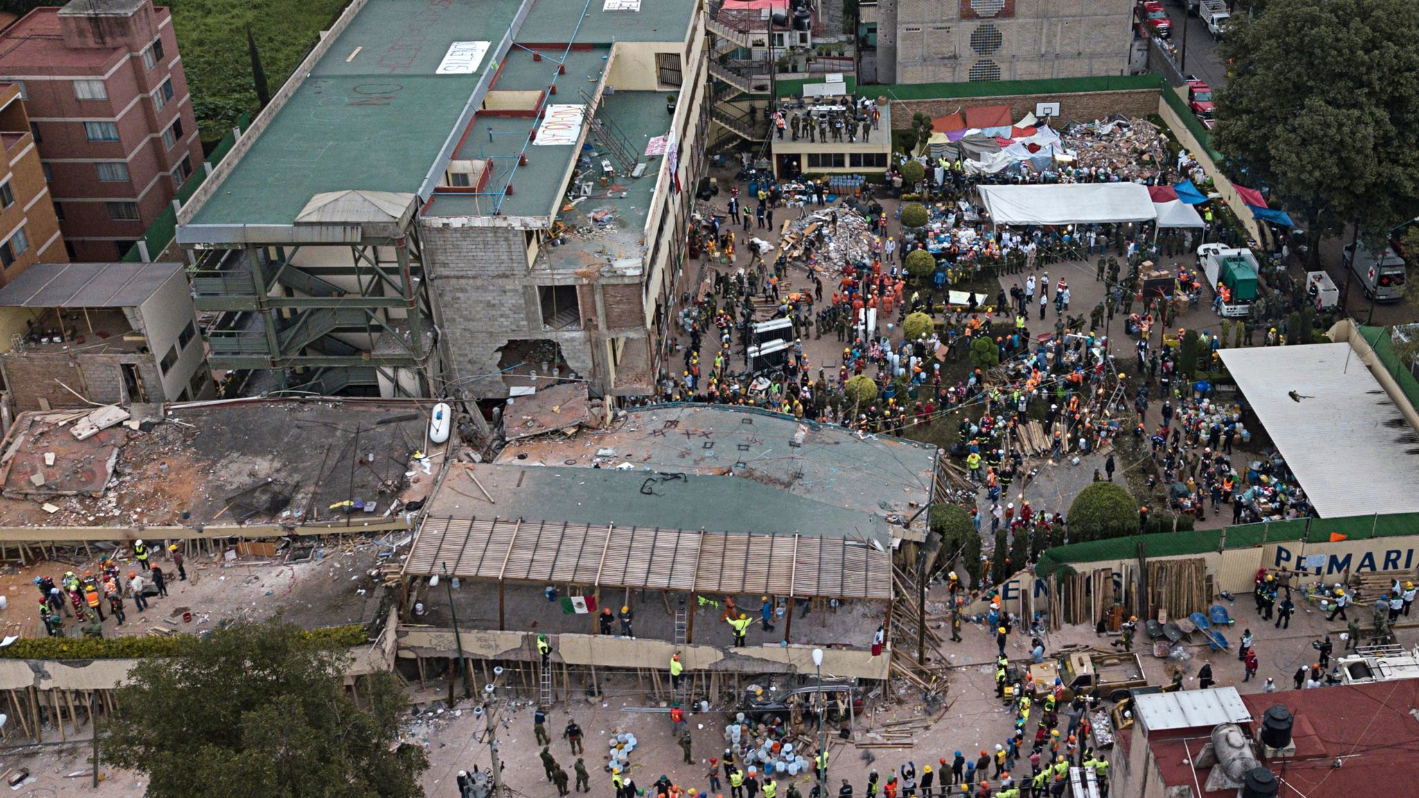 At least 105 killed as powerful 7.1 earthquake strikes central Mexico