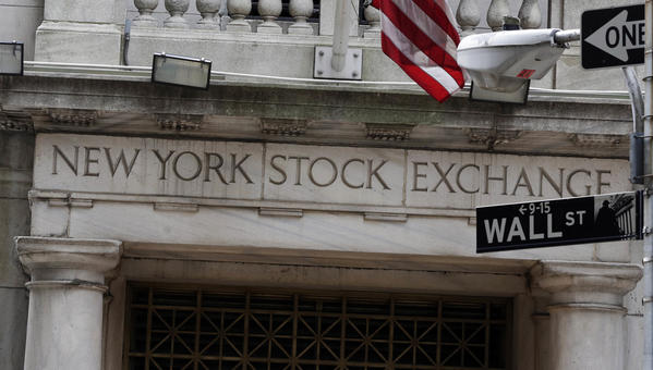 Stocks wobble after Federal Reserve news but close mostly higher