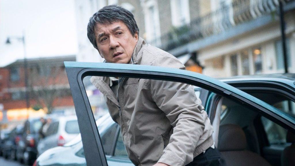 "Quan (Jackie Chan) looks out for his daughter after dropping her off at a local shop just before a fatal bombing occurs in ""The Foreigner."""