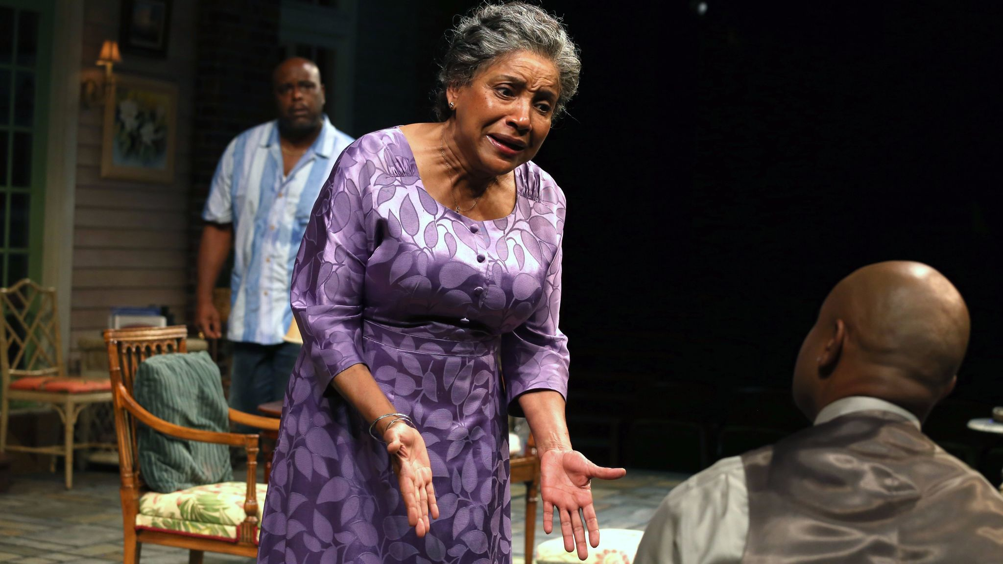 """Phylicia Rashad, speaking to her """"Head of Passes"""" castmate Francois Battiste, with J. Bernard Calloway looking on."""