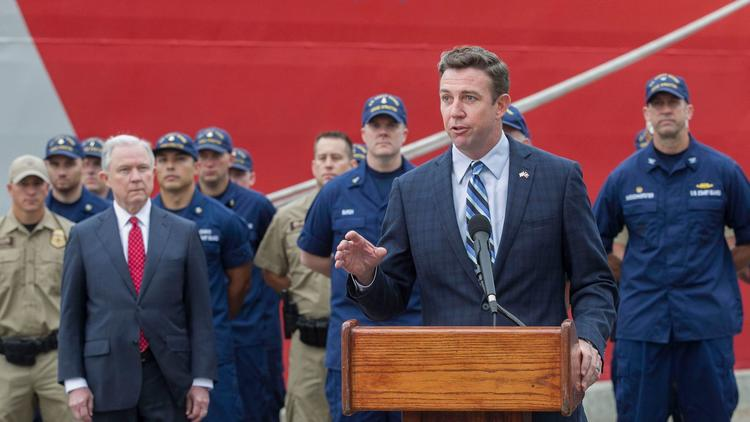 Rep. Duncan Hunter (R-Alpine) introduces U.S. Atty. Gen. Jeff Sessions at a news conference. (John Gibbins / San Diego Union-Tribune)
