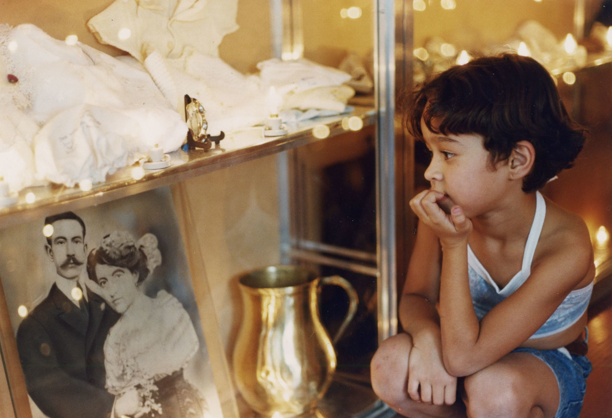 "A child gazes at objects gathered in Suzanne Lacy's ""Skin of Memory,"" which gathered objects from a neighborhood in Medellín that was at the heart of the drug wars."