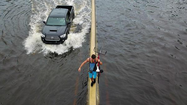Failing dam prompts evacuations as Puerto Rico grapples with flooded roads and shredded power lines