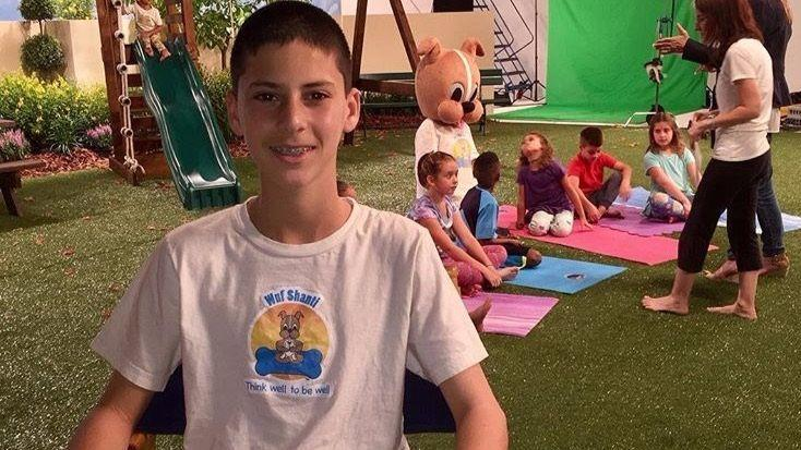 Thirteen-year-old Adam Avin created Wuf Shanti a dog that teaches yoga and meditation to kids.