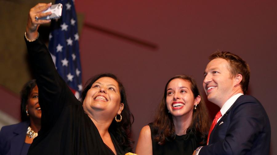 Los Angeles Unified board members Monica Garcia, left, Kelly Gonez and Nick Melvoin pose for a selfie in July. (Allen J. Schaben / Los Angeles Times)