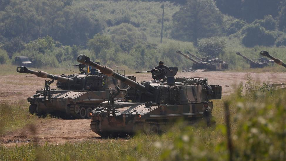 South Korean self-propelled howitzers take part in an exercise at the Mugeon-ri drill field near the demilitarized zone in Paju on September 4th. — Photograph: Jeon Heon-kyun/European Pressphoto Agency.