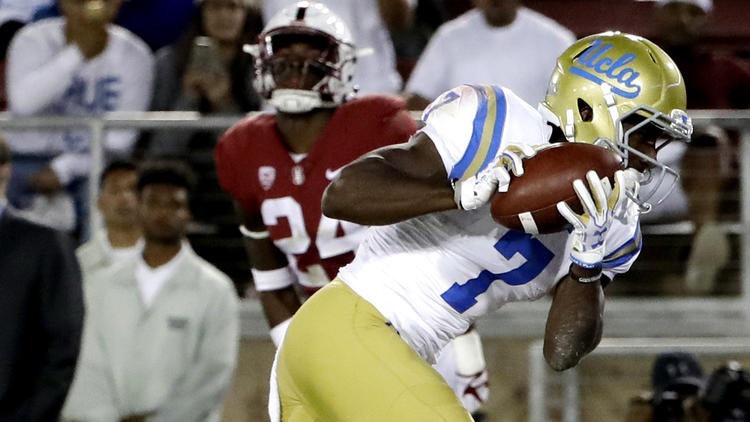 UCLA wide receiver Darren Andrews catches a touchdown pass during the first half. To see more images from the game, click on the photo above. (Marcio Jose Sanchez / Associated Press)