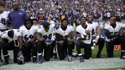 More than 200 NFL players sit or kneel during national anthem